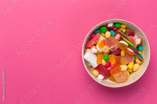 Fototapeta  Colorful lollipops on a pink background