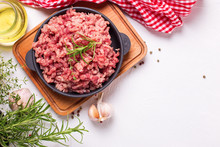 Raw Minced Meat In Bowl  With Ingredients For Cooking