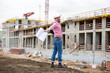 Architect at a construction site celebrate after construction project was successful