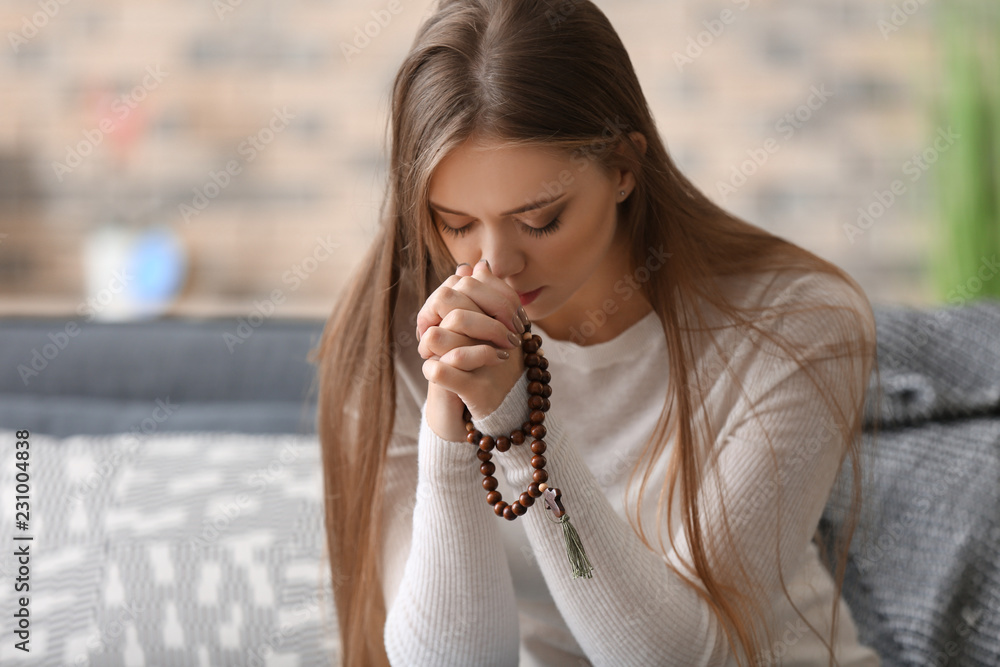 Fototapety, obrazy: Beautiful young woman praying at home