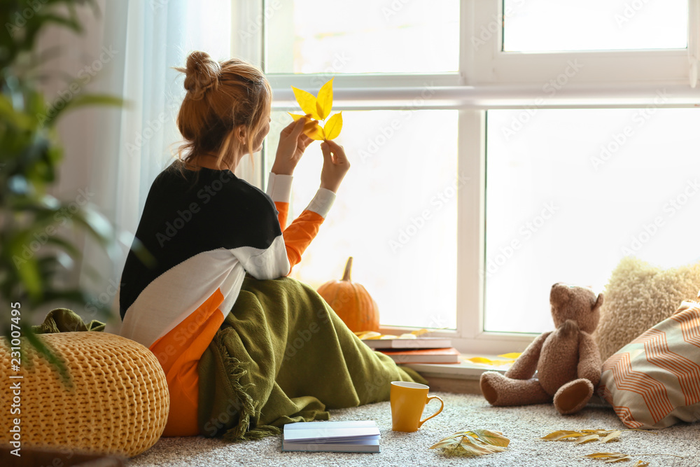Fototapety, obrazy: Woman resting at home on autumn day