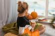 Leinwandbild Motiv Woman drinking tea while resting at home on autumn day