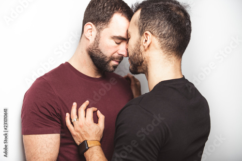 Young homosexuals gay couple love each other on a white background Wallpaper Mural