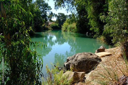 Green waters of the River Jordan in Israel