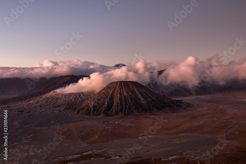 Keuken foto achterwand Lavendel Heavy smoking coming from the Mount Bromo crater during sunrise