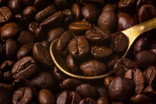Golden Metal Spoon In Coffee Beans