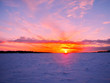 Winter sunset over frozen Baltic Sea in Finland