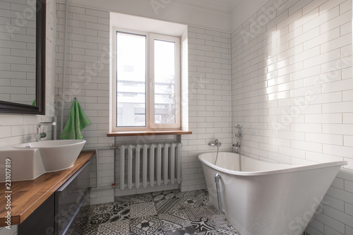 Fotografia  White beautiful attic bathroom in pastel gray and nude colours, with spectacular