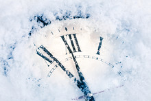 New Year's Clock In The Snow. ...