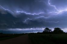A Lightningbolt Creeps Through The Sky Over Nebraska