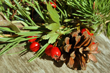 Christmas Wreath With Wild Dog Rose Berries, Pine With Cone, Gray Wooden Surface, Close Up Detail