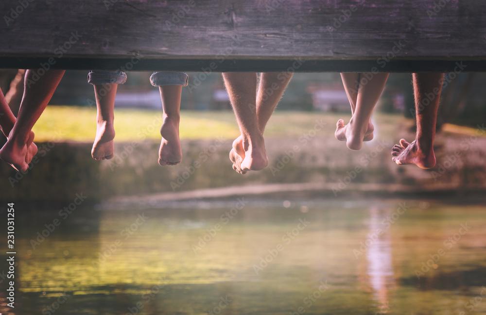Fototapety, obrazy: people sitting at wooden bridge
