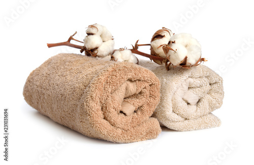 Branch of cotton and two baige cotton towels isolated on white background Obraz na płótnie