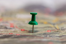 Macro Of Green Pin Marks A Location Of A Destination On A Map