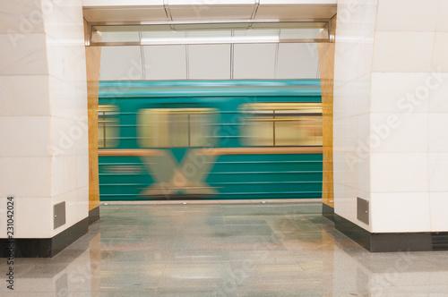 Moving train at subway station