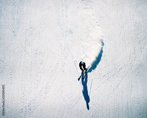 Overhead view of man skiing in snowy landscape