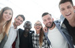 young businesspeople are embracing and smiling