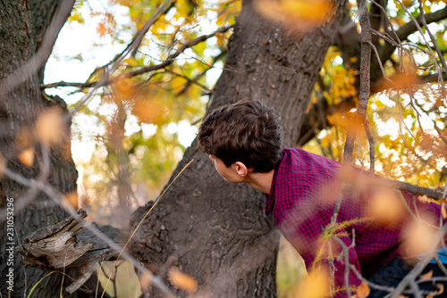 children playing hide and seek in the park Canvas Print
