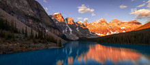 Golden Morning Light Hits Mountain Peaks At Moraine Lake
