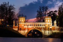 The Figured Bridge In Tsaritsyno Park Illuminated At Dusk. Moscow, Russia.