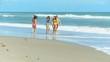 Carefree Caucasian Family Enjoying Beach Vacation