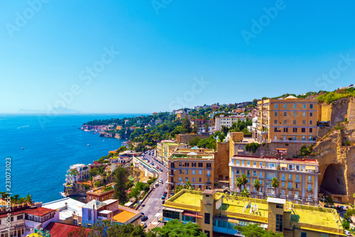 View of the coast of Naples with clear blue sky. Houses on the shore of the Gulf of Naples. Italy, Europe.