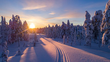 Sunset On A Snow Covered Road In Finland