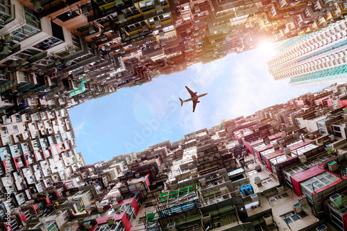 fototapeta na ścianę Plane Flying Over Crowded Houses in Quarry Bay, Hong Kong