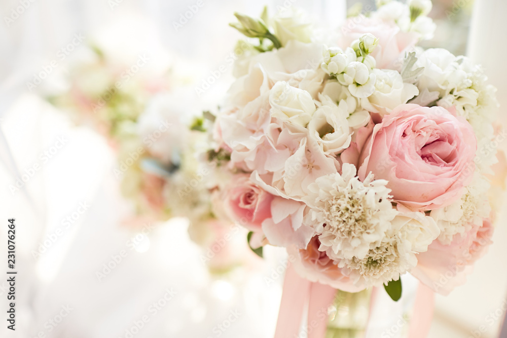Fototapeta Wedding decor. Bright pink rose bouquet for a bride and bridesmaids stand before a window