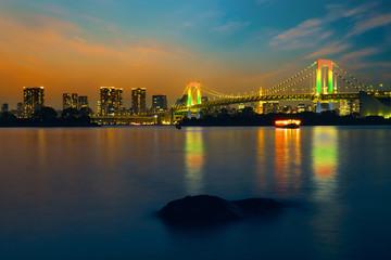 Fototapeta Colorful illuminations at Rainbow Bridge from Odaiba in Tokyo, Japan