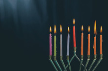 The Lit Of Hanukkah Candles In Menorah On Blue Background