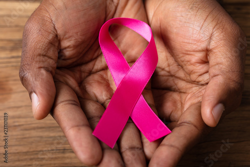 Valokuvatapetti Man Holding Pink Ribbon
