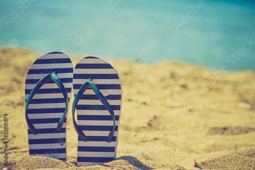 Flip flops on sand beach
