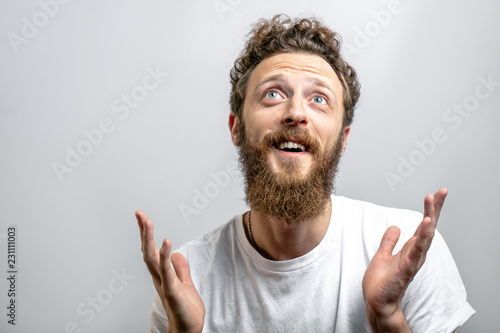 Stampa su Tela Happy middle-aged handsome man giving thanks to God for a successful marriage an