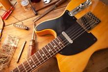 Guitar On Repair Desk. Vintage...