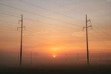 Power Line In Fog In The Early Morning