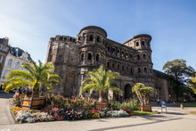Trier, Germany. The Porta Nigra (Latin For Black Gate), A Large Roman City Gate Of The Ancient City Of Augusta Treverorum. A World Heritage Site Since 1986