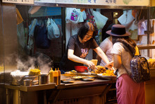 Travelers Thai Woman Select And Buy Cuisine From Street Food In Hong Kong, China