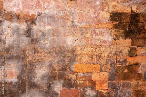 Poster Graffiti Solid brick wall. Orange bricks closeup. Weathered grungy brick wall photo background. Grunge texture of brickwork.