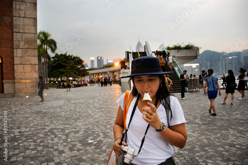 Spoed Foto op Canvas Aziatische Plekken Travelers thai woman travel visit and eating ice cream at square of Former Kowloon-Canton Railway Clock Tower in Hong Kong, China