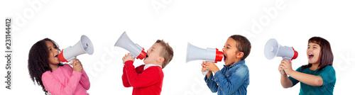 Valokuva Funny children shouting through a megaphone to his friend