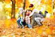 canvas print picture - Happy Familiy in Sunny Autumn Landscape