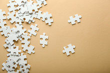Pieces Of Jigsaw Puzzle On Color Background
