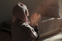 Young Muslim Woman Praying At ...