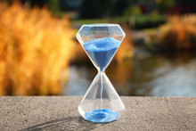 Crystal Hourglass With Blue Sand Outdoors