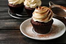 Tasty Chocolate Cupcake On Plate