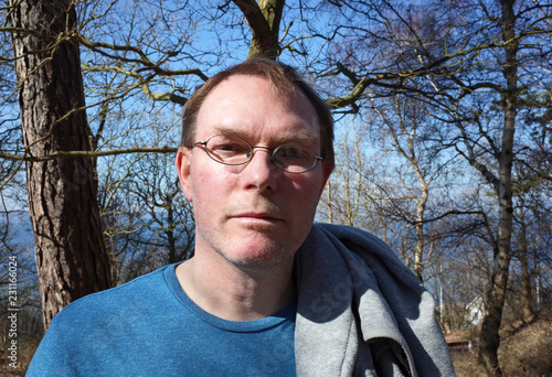 Outdoor portrait of handsome adult serious looking man, Swedish.