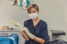 Dental Surgeon Wearing Surgical Mask, Putting On Surgical Gloves