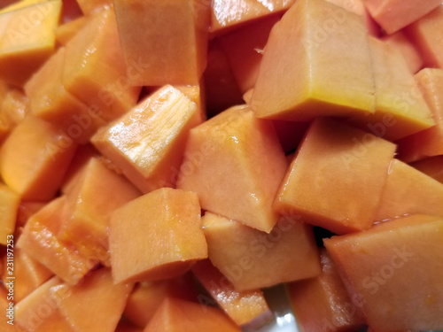 Fotografie, Obraz  Ripe juicy and sweet papaya fruit sliced and diced in a bowl