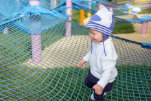Cute Little Asian 2 Years Old Toddler Baby Boy Child Having Fun Trying To Climb On Jungle Gym At Outdoor Playground, Physical, Hand And Eye Coordination, Sensory, Motor Skills Development Concept